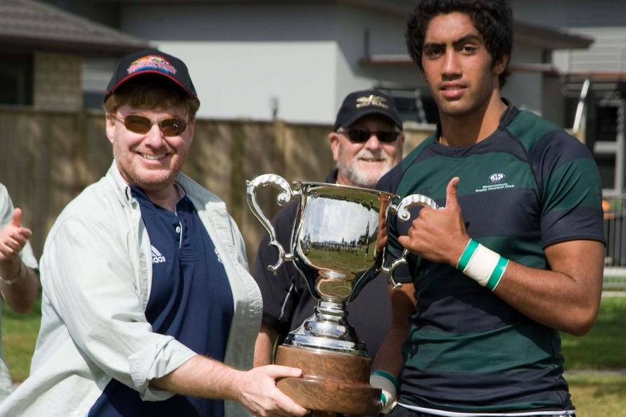 Ambassador David Huebner presents Cup to Wainuiomata Rugby Club captain, by Ola Thorsen, U.S. Embassy