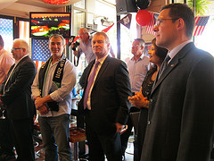 World Cup-winning former All Blacks Steve McDowell (l, with scarf) and Grant Fox, with US Consul in Auckland, Dana Deree