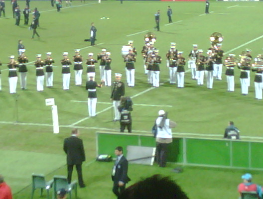 30 minutes to kick off here at Taranaki stadium. Go Eagles! USMC performing for the crowd.